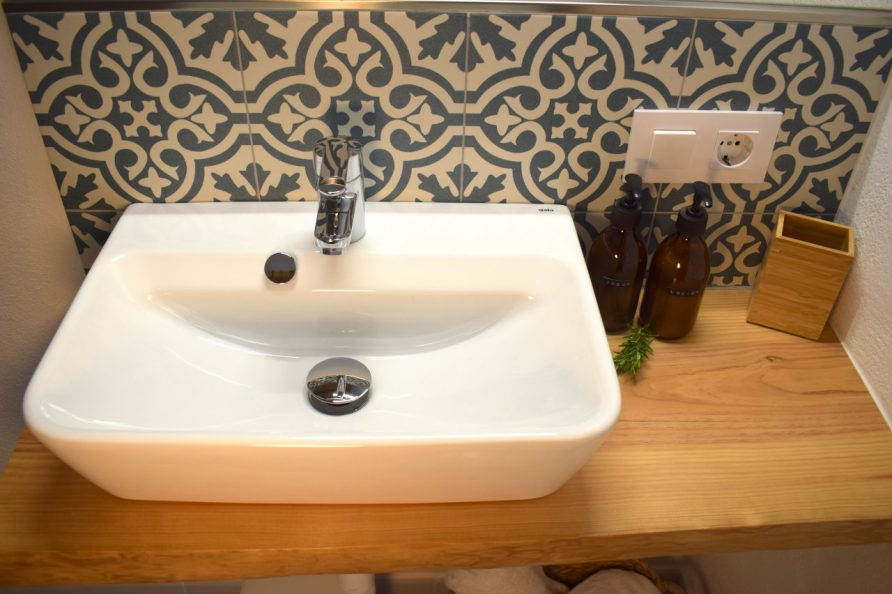 close up of sink with Moorish tiles